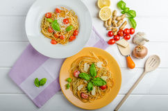 Lemon pasta with cherry tomatoes, basil and nuts Royalty Free Stock Photography