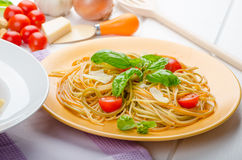 Lemon pasta with cherry tomatoes, basil and nuts Royalty Free Stock Photos