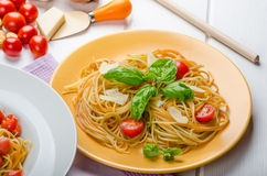 Lemon pasta with cherry tomatoes, basil and nuts Stock Photos