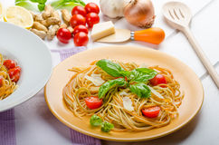 Lemon pasta with cherry tomatoes, basil and nuts Stock Photography