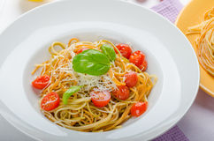 Lemon pasta with cherry tomatoes, basil and nuts Royalty Free Stock Photo