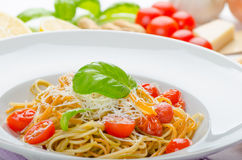 Lemon pasta with cherry tomatoes, basil and nuts Stock Photo