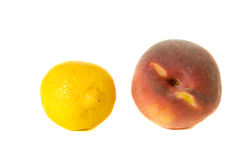 Lemon and peach isolated on white background Royalty Free Stock Photo