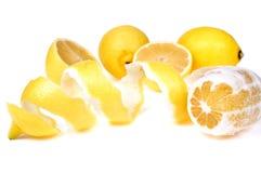 Lemon with peel. Lemon with spiral peel isolated on white background Royalty Free Stock Image