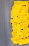 Lemon peel. Peel, lined coat on blue texture. Ukrainian flag, the texture of two colors stock photo