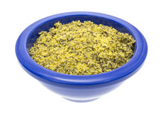 Lemon pepper seasoning in a blue bowl Royalty Free Stock Photo