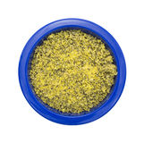 Lemon pepper seasoning in a blue bowl Stock Images