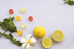 Lemon ,peppermint herbal for cough sore throat and colorful pills. On background white stock photo