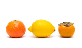 Lemon, persimmon and tangerine isolated on white background Stock Photo