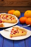 Lemon pie with condensed milk decorated with fresh cranberries a Stock Image