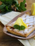 Lemon pie with mint leaves Stock Photos
