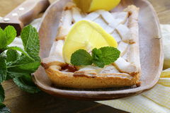 Lemon pie with mint leaves Stock Image