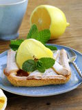 Lemon pie with mint leaves Royalty Free Stock Images