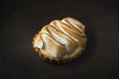Lemon pie on a tart on a black background Royalty Free Stock Photography