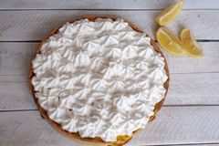 Lemon pie with white cream on the table royalty free stock photography