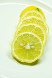 Lemon pieces. Lemon cut in pieces on a plate Royalty Free Stock Images