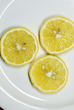 Lemon pieces. On a white plate Royalty Free Stock Images
