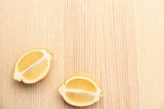 Lemon pieces on table