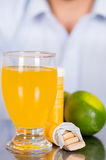 Lemon, pills of vitamin C and a glass of vitamin C dissolved over the table.  Royalty Free Stock Photography