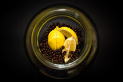 Lemon and pine nuts in a glass jar on a black background Royalty Free Stock Photos