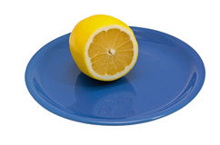 Lemon on plate Royalty Free Stock Photos