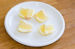 Lemon on plate Royalty Free Stock Images