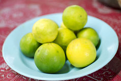 Lemon on a plate on plate. Lemon on a plate on a red background Royalty Free Stock Image