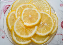 Lemon on a plate Stock Images