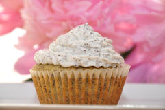 Lemon Poppy Seed Cupcake. With flowers royalty free stock images