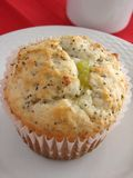 Lemon poppyseed muffin on white plate. And red cloth Royalty Free Stock Photos
