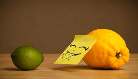 Lemon with post-it note sticking out tongue to lime Royalty Free Stock Images