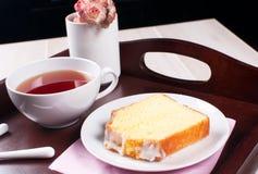 Lemon pound cake with tea on a tray Royalty Free Stock Photos