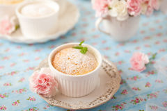 Lemon pudding cake. Decorated with green mint leaves Stock Photos