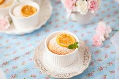 Lemon pudding cake. Decorated with green mint leaves and caramelised lemon slice Stock Photo