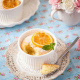 Lemon pudding cake. Decorated with green mint leaves and caramelised lemon slice Royalty Free Stock Images