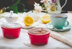 Lemon pudding red saucers, tea, english dessert Royalty Free Stock Photography