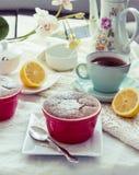 Lemon pudding red saucers, tea, english dessert Royalty Free Stock Photo