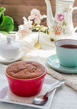 Lemon pudding red saucers, tea, english dessert Stock Photos