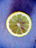 Lemon on a purple backround Royalty Free Stock Photo