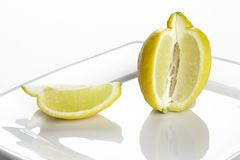 Lemon and a quarter Royalty Free Stock Photos