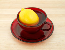 Lemon in red cup with water Royalty Free Stock Image