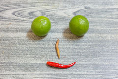 Lemon red pepper fingerroot is face on wood background Royalty Free Stock Image