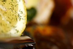 Lemon with red wine sauce Stock Image