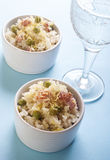 Lemon rice with bacon and peas in a cup Royalty Free Stock Photo