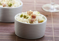 Lemon rice with bacon and peas in a cup Stock Photography