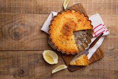Lemon and ricotta cheese cake. With thyme on wooden background, selective focus royalty free stock images