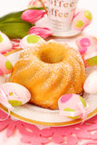 Lemon ring cake for easter. Lemon ring cake with icing sugar on easter table Stock Photos