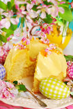 Lemon ring cake on easter table. Lemon ring cake with yellow icing sugar on easter table Royalty Free Stock Images
