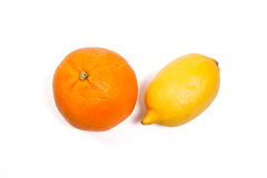 Lemon and Ripe orange isolated on white. With clipping path. Stock Photo