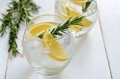 Lemon and rosemary soda. Lemon and rosemary refreshing alcoholic drink, soda or fizz Royalty Free Stock Photography